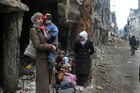 Millions of Syrians have been displaced as rebel groups try take on President Bashar al-Assad's regime. Picture / AP