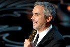 Alfonso Cuaron accepts the award for best director for Gravity during the Oscars. Photo/AP