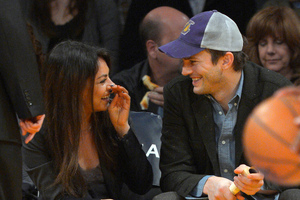 Mila Kunis and Ashton Kutcher are expecting their first child together, reports say. Photo/AP