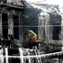 A firefighter inspects a charred home while standing on a ladder from a fire truck in Jersey City, New Jersey. Photo / AP