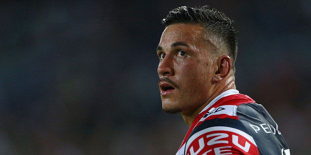 Sonny Bill Williams looks up at a replay of his shoulder charge during the round one NRL match between the South Sydney Rabbitohs and the Sydney Roosters. Photo / Getty Images.