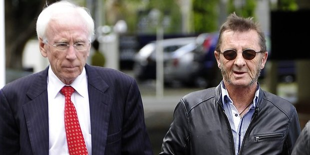 AC/DC drummer Phil Rudd (right) moments after leaving Tauranga District Court yesterday with his lawyer Paul Mabey. Photo/George Novak