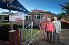 Grey Power life members Ashton Peat (left) and Terry Hawkey (right) were on hand to help open the new Rotorua Grey Power office with president Rosemary MacKenzie. Photo / Andrew Warner