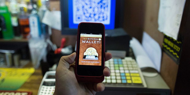 The Bitcoin smartphone app shown on a smartphone. Newsweek magazine says it has found the mysterious creator of the online currency. Photo / AP