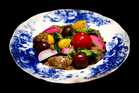 Devilled lamb's kidneys with cherry tomatoes and radishes, by Joao Martins from The Offal Club. Photo / Babiche Martens