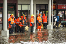 City council workers sand bag shops in Shirley, Christchurch. Photo / Getty Images