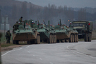 Russian armoured personnel carriers and a truck are parked on the side of the road near the town of Bakhchisarai, Ukraine. Photo / AP