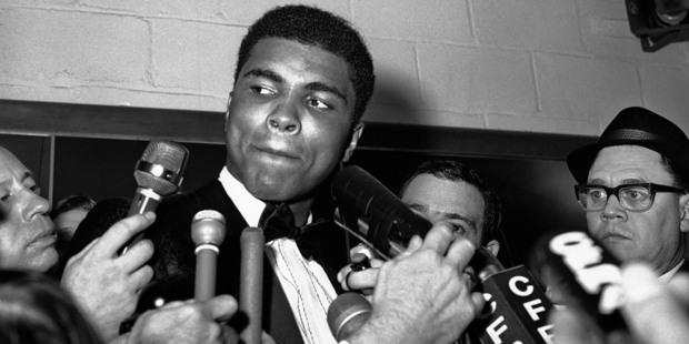 Reporters surround Muhammad Ali in Toronto. Photo / AP