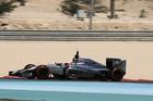 Formula One driver Jenson Button of McLaren speeds down the track during pre-season testing at the Bahrain International Circuit in Sakhir, Bahrain. Photo / AP