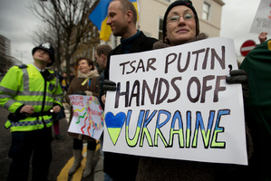 Pro-Ukraine supporters based in London send their message to Russian president Vladimir Putin. The crisis could have implications for NZ's Security Council ambitions. Photo / AP