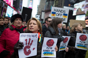 Demonstrators against Russian military actions in Ukraine rally in Times Square. Photo / AP