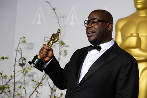 Director Steve McQueen with his award for best picture for 12 Years a Slave. (Photo AP)