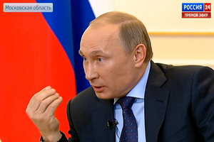 In this frame grab provided by the Russian Television via the APTN, President Vladimir Putin, during a live feed, answers journalists' questions on the current situation around Ukraine.