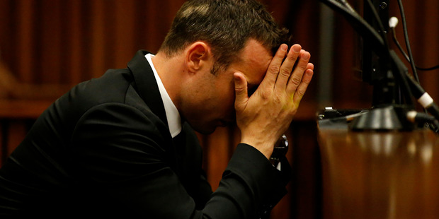 Oscar Pistorius sits in the dock in court on the third day of his trial at the high court in Pretoria. Photo / AP