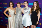 Lena Dunham (second left) - wearing a Rochas gown - with her Girls co-stars Jemima Kirke, Allison Williams and Zosia Mamet. Photo / AP Images