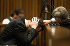 Oscar Pistorius, puts his hands to his head while listening to evidence from a witness speaking about the morning of the shooting of his girlfriend Reeva Steenkamp. Photo / AP