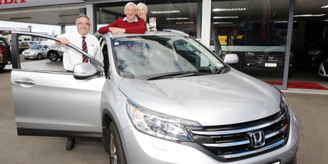 Norm and Barb Wilkinson with Honda's Neil Dunn and the new car they ended up paying nothing for. Photo/Paul Taylor