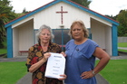 Parishioners Maata Job Rakena, left, and Jeanette Kinneally with a 400-signature petition calling on the Marist order to keep its nuns in Waitaruke. Photo/Peter de Graaf