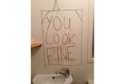 The mirror in the ladies toilet at Raglan venue The Yot Club.