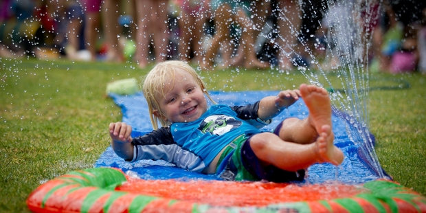 Dylan Percival-Carter, 5, hits the slippery slide at the Browns Bay Village Green yesterday afternoon. Photo / Sarah Ivey
