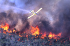 A water bomber works over a large fire burning throughout Victoria's Grampians region. Photo / AP