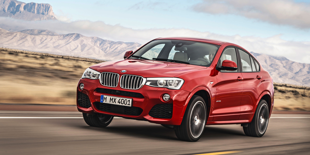 BMW X4 is a sportier derivative of the X3 with a silhouette that's reminiscent of a coupe and a slightly more aggressive-looking body.