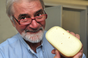 Master Judge Russell Smith with Aged Gouda Barrys Bay Traditional Cheese.
