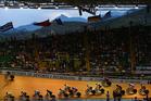 Riders in the Madison lap the field during day five of the 2014 UCI Track Cycling World Championships at the Velodromo Alcides Nieto Patino. Photo / Getty Images