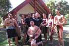 Waitangi National Trust staff celebrate news of a $5.75 million grant for a new museum, with cultural director Mori Rapana and chief executive Greg McManus at centre, surrounded by performers of Te Pito Whenua cultural group. Photo / Peter de Graaf