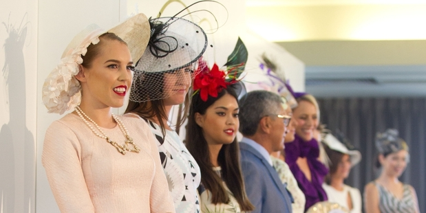 Herald reporter Morgan Tait (left) lines up in the Prix de Fashion at the TV3 NZ Derby Day at Ellerslie on Saturday. Photo / Richard Robinson
