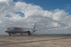 Jetstar's Dreamliner gets a firetruck welcome as it arrives at Auckland Airport last week.