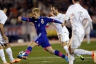 Comedy gold as Japan's AC Milan midfielder Keisuke Honda slices through the All Whites' defenders. Photo / AP