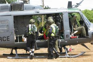 An Air Force Iroquois Helicopter was used to winch police officers down into cannabis plots.