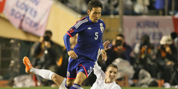 Yuto Nagatomo of Japan steals the ball from Chris James. Photo / Getty Images