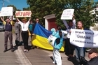 A small group of Ukrainian supporters gathered outside the Russian Embassy in Wellington to protest against Soviet troops entering the Ukraine and the potential for an escalation of the violence into war.