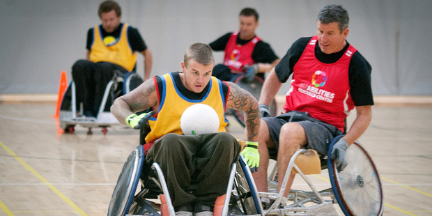 Scott MacDonald, chased by Lester Phelps, speeds away with the ball in the second division wheelchair rugby champs at the weekend.