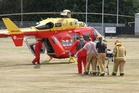 RESCUE: The Life Flight Westpac rescue helicopter transports a burn victim to Hutt Hospital.PHOTO/FILE
