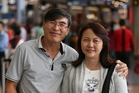 Alex and Adeline Tan, returning to Malaysia, feel safer with the extra security. Photo / Jason Oxenham