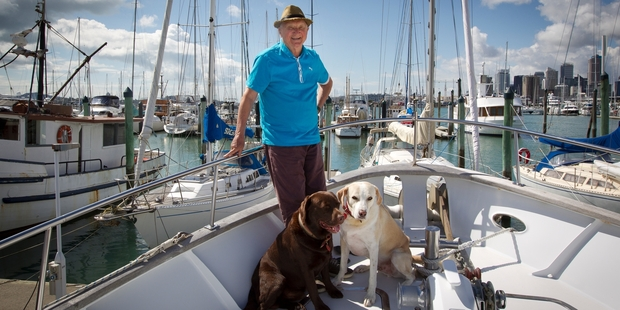 Peter Williams on his boat with his dogs, Kafka and Ariki, at Westhaven Marina. Photo / Sarah Ivey