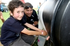 Remy Majsa, then aged 7, was watched by volunteer Mark Laurence as he milked the