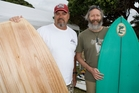Grant Newby, left, and Rich Pavel, of San Diego, admire some of the surfboards on display at the first Fish Fry event in New Zealand held at Waipu. Photo/Ron Burgin