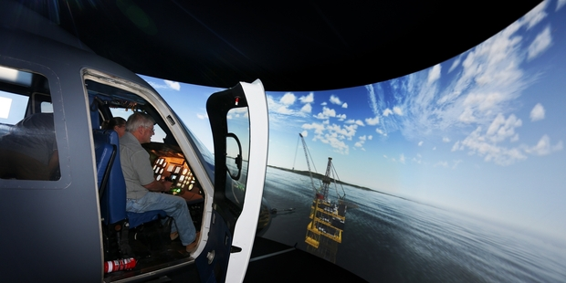 AUTHENTIC: Chief pilot Pete Turnbull tests the new flight simulator and approaches an offshore oil rig near the Hen and Chicken Islands. PHOTO/MICHAEL CUNNINGHAM