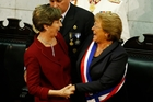 Chile Senate leader Isabel Allende, left, embraces newly sworn-in President Michelle Bachelet. Photo / AP