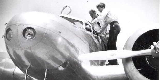 Amelia Earhart and a mechanic check her repaired flying laboratory plane before she took off on her test flight from Burbank California to the Oakland airport. Photo / Wide World Press