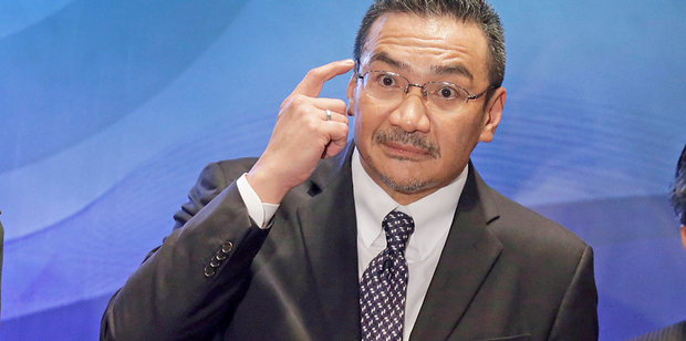 The Acting Minister of Transport turned defensive when an exasperated Malaysian reporter asked why the facts kept changing. Photo / AP