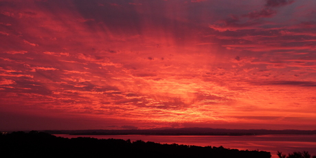 Today's sunrise taken from Parau looking toward south Auckland and the Hunua Ranges. Photo / Andrew Blackler