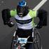 Wheelchair athlete Lee Warn makes his way along Tamaki Drive, during the Round The Bays fun run. Photo / New Zealand Herald / Brett Phibbs