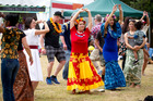 People learn Tahiti dance during the Pasifika Festival held at Western Springs. 09 March 2014 New Zealand Herald Photograph by Dean Purcell.