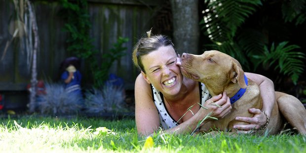 Terri Mann with her and her partner's adopted 9-month-old pitbull terrier cross renamed Delvinious or Del for short. Photo/George Novak