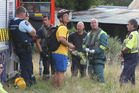 Waldorf Steiner School teacher Mario Gude speaks with emergency staff at Otawa Track while  waiting for a teacher to be airlifted to Tauranga Hospital. Photo / John Borren